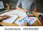 close up of young creative... | Shutterstock . vector #695496589