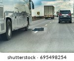 editorial use only  tire debris ... | Shutterstock . vector #695498254