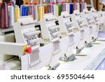 row of sewing machine on... | Shutterstock . vector #695504644