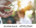 young man holding a diamond... | Shutterstock . vector #695512564