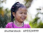 cute asian child girl having... | Shutterstock . vector #695524999