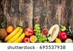 variety of fresh fruits. on a... | Shutterstock . vector #695537938
