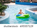 little boy sitting in... | Shutterstock . vector #695557129