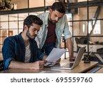 attractive businessmen in... | Shutterstock . vector #695559760