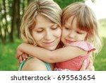 Small photo of happy parent mother with child play outdoors in the park