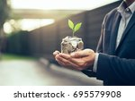 businessman cover growing plant ... | Shutterstock . vector #695579908