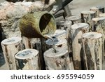 melting gold and antiques to... | Shutterstock . vector #695594059