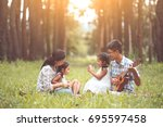 happy family father playing... | Shutterstock . vector #695597458