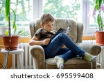 cute blond little kid boy... | Shutterstock . vector #695599408