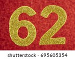 Small photo of Number sixty-two golden color over a red background. Anniversary. Horizontal