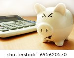 angry piggy bank. problems with ... | Shutterstock . vector #695620570
