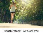sport girl running in the park...   Shutterstock . vector #695621593