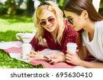 y generation girls searching in ...   Shutterstock . vector #695630410