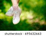 dangling hanging female legs of ... | Shutterstock . vector #695632663