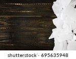 torn paper on wooden dark... | Shutterstock . vector #695635948