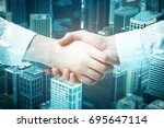 close up of handshake on... | Shutterstock . vector #695647114