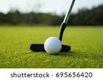 golfer putt ball to hole on... | Shutterstock . vector #695656420