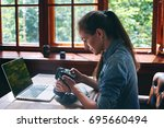 portrait of a girl photographer ... | Shutterstock . vector #695660494