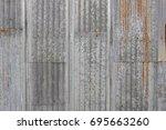 old metal sheet roof texture.... | Shutterstock . vector #695663260