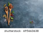 wooden spoons with spices on... | Shutterstock . vector #695663638