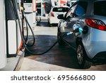 fuel pump filling a car at a...   Shutterstock . vector #695666800