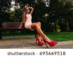 sexy blond girl in pink heels... | Shutterstock . vector #695669518