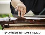 the chinese play the guqin scene | Shutterstock . vector #695675230