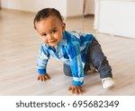 happy mixed race toddler boy | Shutterstock . vector #695682349