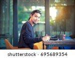 asian freelance man working on... | Shutterstock . vector #695689354