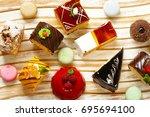 assorted mini cakes sweet... | Shutterstock . vector #695694100