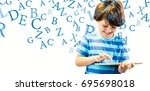 smiling boy using digital... | Shutterstock . vector #695698018