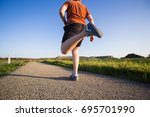 athletic young man running in... | Shutterstock . vector #695701990