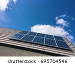 low angle view of solar panel... | Shutterstock . vector #695704546