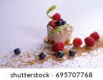 fruit cake and red berries | Shutterstock . vector #695707768