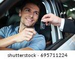 smiling happy man sitting in... | Shutterstock . vector #695711224