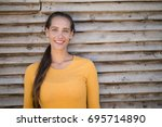 portrait of smiling young... | Shutterstock . vector #695714890