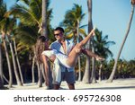 honeymoon couple on white sandy ... | Shutterstock . vector #695726308