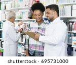 chemist explaining prescription ... | Shutterstock . vector #695731000