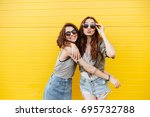 image of two young happy women... | Shutterstock . vector #695732788