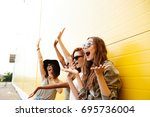 picture of four young happy... | Shutterstock . vector #695736004