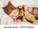 cute newborn baby sleeps with a ... | Shutterstock . vector #695743810