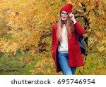 autumn portrait of happy blonde ... | Shutterstock . vector #695746954