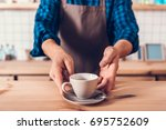 cropped shot of barista in... | Shutterstock . vector #695752609