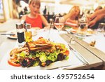 seafood salad served in the... | Shutterstock . vector #695752654