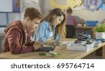 boy programs technical part of... | Shutterstock . vector #695764714