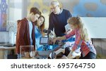 teacher and his pupils work on... | Shutterstock . vector #695764750