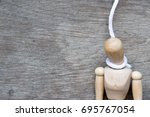 wood figure with the rope in... | Shutterstock . vector #695767054