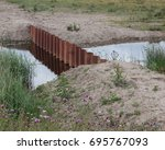 Small photo of Metal shutters across drainage ditch, St Aidans nature park