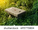 Small photo of The stone chair in public park. feel lonely. feel single. feel peaceful.
