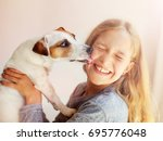 happy child with dog. portrait... | Shutterstock . vector #695776048